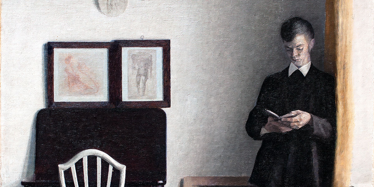 Vilhelm Hammershøi. Interior with Young Man Reading